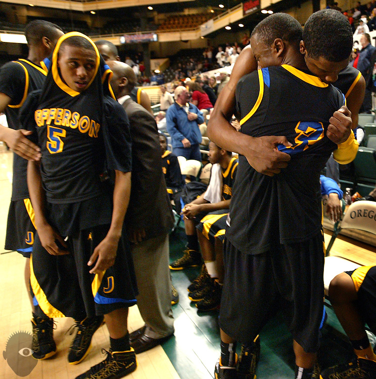 03/13/2010 - Jefferson's Terrence Jones (1) hugs teammate Antoine Hosley (3) as teary-eyed teammate B.J. Jones (5) looks on as they celebrate their win. Jefferson beat Mountain View 57-48 in the 2010 OSAA 5A Basketball State Championship game from Mac Court on the University of Oregon.