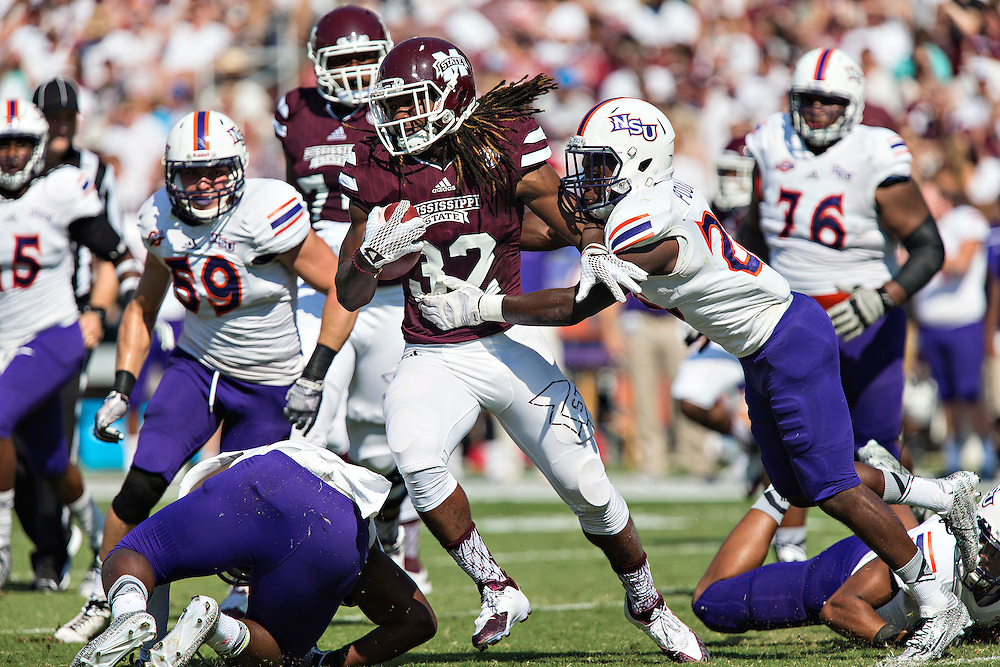 STARKVILLE, MS - SEPTEMBER 19:  Ashton Shumpert #32 of the Mississippi State Bulldogs is tackled by Darius Pollard #26 of the Northwestern State Demons at Davis Wade Stadium on September 19, 2015 in Starkville, Mississippi.  (Photo by Wesley Hitt/Getty Images) *** Local Caption *** Ashton Shumpert; Darius Pollard