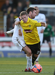 Burton Albion's Lee Bell is fouled by Hereford United's Josh O'Keefe - Photo mandatory by-line: Matt Bunn/JMP - Tel: Mobile: 07966 386802 10/11/2013 - SPORT - FOOTBALL - Pirelli Stadium - Burton upon Trent - Burton Albion v Hereford United - FA Cup