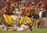 September 26, 2009: Iowa State quarterback Austen Arnaud (4) pulls away from a defender on his way to a 14 yard touchdown run during the second half of the Iowa State Cyclones' 31-10 win over the Army Black Knights at Jack Trice Stadium in Ames, Iowa on September 26, 2009.