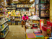 10 JULY 2018 - NAKHON PATHOM, THAILAND:  A man sells Buddhist statues and ceramics in the market in Nakhon Pathom. Nakhon Pathom is about 35 miles west of Bangkok. It is one of the oldest cities in Thailand, archeological evidence suggests there was a settlement on the site of present Nakhon Pathom in the 6th century CE, centuries before the Siamese empires existed. The city is widely considered the first Buddhist community in Thailand and the nearly 400 foot tall Phra Pathom Chedi is considered the first Buddhist temple in Thailand.    PHOTO BY JACK KURTZ