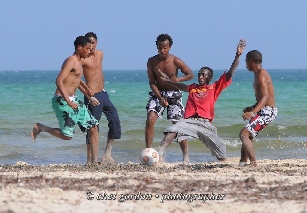 Kenyan men play soccer at Bamburi Beach in Mombasa, Kenya on Thursday, December 8, 2011.