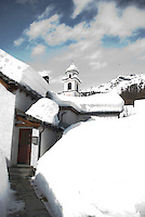 Ticino, Southern Switzerland. The tiny, picturesque village of Bosco Gurin in deep snow.