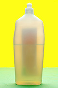 semi transparent plastic bottle with liquid content object on yellow green background