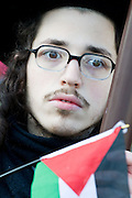 The face of protest - Pro Israel demonstration is met by supporters of Palestine, Trafalgar Square, London 10 January 2009.