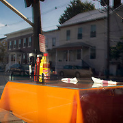 Downtown Smithsburg, Maryland is reflected in the window of the Dixie Diner, on Tuesday, September 26, 2017. Smithsburg is a very different town than the southern part of the district that includes Potomac and Germantown. Originally a District that was mostly rural, but included towns like Frederick and Hagerstown, Maryland's 6th District was redistricted in 2011, combining rural northern Maryland regions with more affluent communities like near Washington D.C. turning the district from Republican to Democrat. <br />  <br /> CREDIT: John Boal for The Wall Street Journal<br /> GERRYMANDER