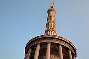 Looking up at the Siegessaule or Berlin Victory Column, designed by Heinrich Strack and inaugurated 1873 to celebrate the victories of the Prussian army in the Danish-Prussian war, Austro-Prussian war and Franco-Prussian war, at the Grosser Stern, Grosser Tiergarten Park, Berlin, Germany. The monument takes the form of a column topped by a giant gilded bronze statue of Victoria by Friedrich Drake and a hall of red granite pillars below. Picture by Manuel Cohen