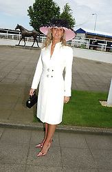 CHANNEL BURKE at Ladies Day at Epsom Racecourse, Surrey during the Derby Festival on 3rd June 2005.<br /><br />NON EXCLUSIVE - WORLD RIGHTS