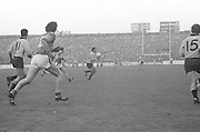 Dublin player mid field looks around for someone to pass the ball to during the All Ireland Senior Gaelic Football Final, Kerry v Dublin in Croke Park on the 28th September 1975. Kerry 2-12 Dublin 0-11.