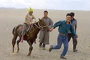 GOBI DESERT, MONGOLIA..08/26/2001.Bayangovi. Local Naadam festival. Winner of a horse race over 30 kilometers..(Photo by Heimo Aga).