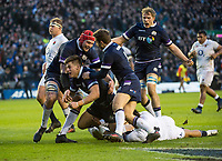 EDINBURGH, SCOTLAND - FEBRUARY 24:  Scotland's Huw Jones is mobbed by teammates at BT Murrayfield on February 24, 2018 in Edinburgh, Scotland. (Photo by MB Media/Getty Images)