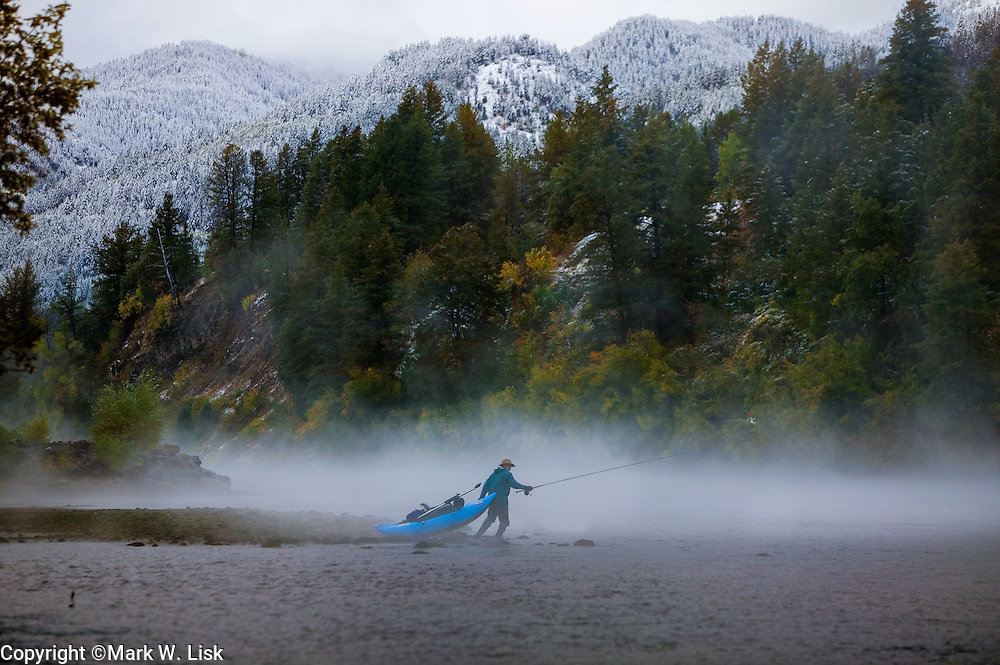 (MR) Fog rises on a steel head fisherman on the South Fork of the Snake River in eastern Idaho.