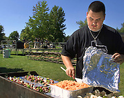 BBQ Hispanic Heritage Month: Photos Tyler Barrick..Junior, Dan Perra, Vice President of Alpha Psi Lamda, stirs a container of rice on a grill while a Salsa band plays in the back ground on Saturday, September 20, 2003, in front of New South...Photo: Tyler Barrick