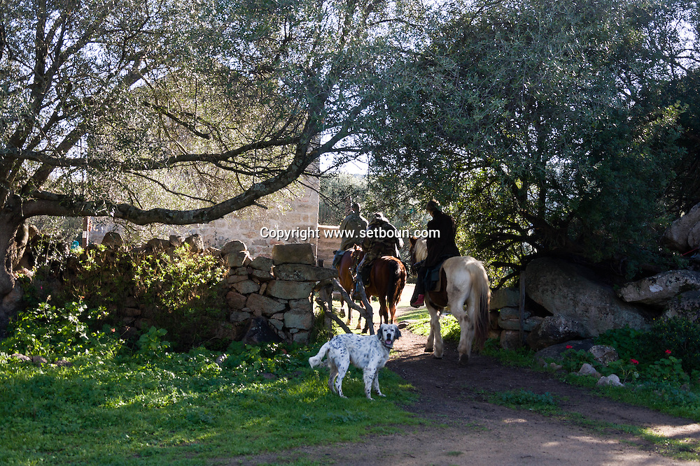 Corsica. France. Horse riding in Mr Preziosi house ,  in Tradicetto  Corsica south  France    / randonnee a cheval arret chez  Mr Preziosi, gite habitat traditionel en pierre  Corse du sud  France  /