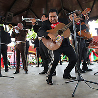 A mariachi band plays on the stage inside of the Parian in central Tlaquepaque, Jalisco, Mexico.
