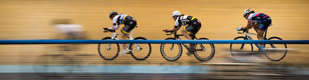 A group of cyclists pass by other  other cyclists during practice at the Velo Sports Center in Carson, California on November 3, 2016.
