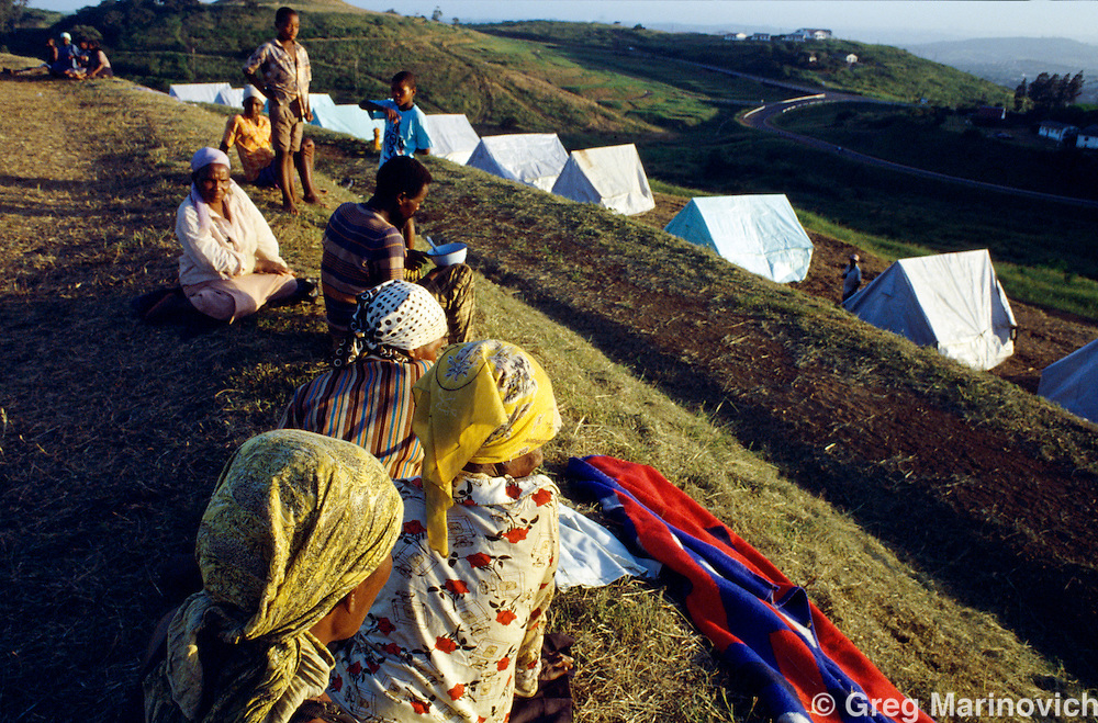 Sonkombo, KwaZulu Natal, 1994, South Africa: A  refugee camp for ANC supporting families from the Sonkombo area from which they had fled months earlier because of attacks by rival IFP. The community was able to retun safely.