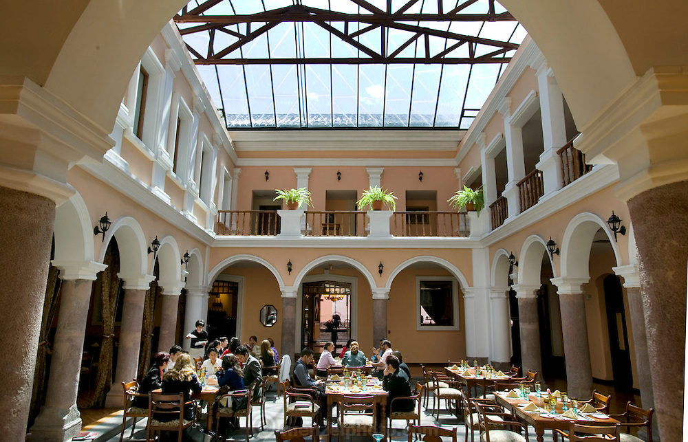 The patio restaurant of a hotel in downtown Quito, Equador.  Photography workshop for South American photojournalists taught by USA professional photographers and editors.