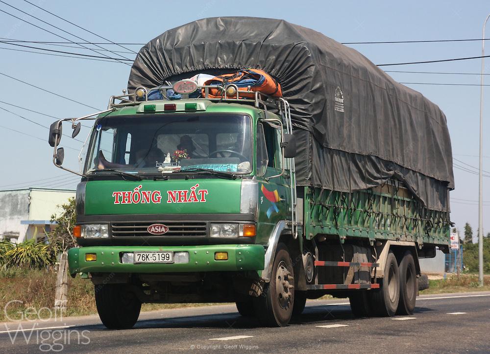 Vietnamese truck speeds down highway 1, Vietnam