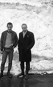 Two skinheads standing in front of snow wall. Switzerland. UK, 1980s.