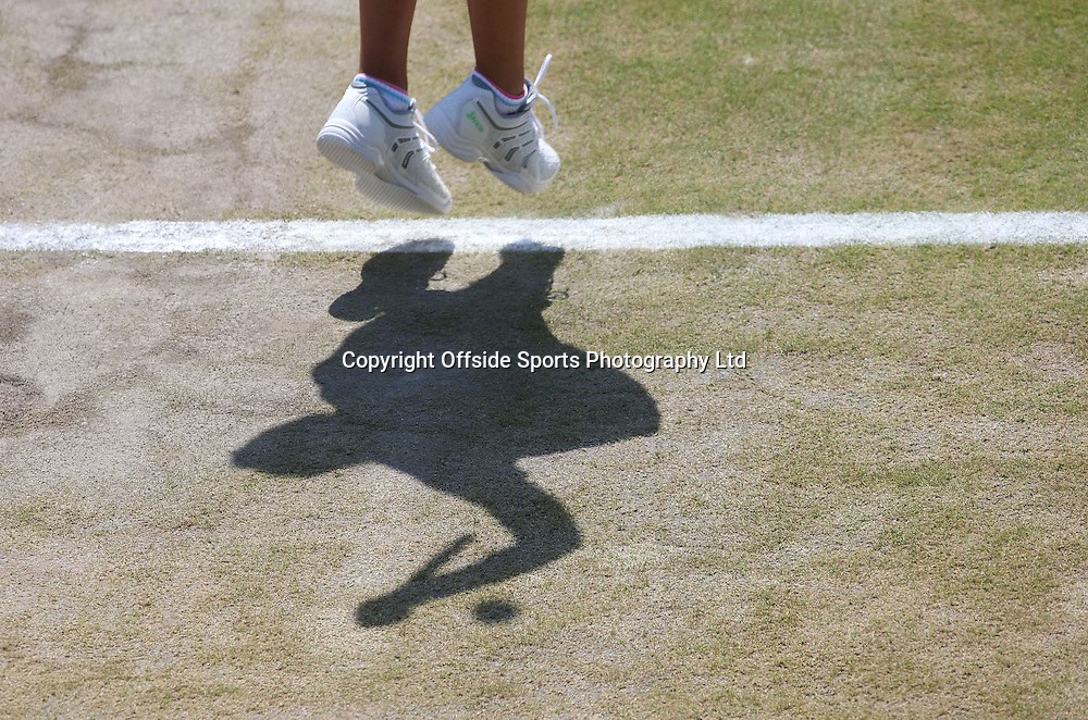 July 01 2014 Day  Eight: The Championships - Wimbledon 2014 <br /> Bare patches appear on the grass courts.<br /> <br /> Photo: Mark Leech