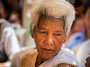 27 FEBRUARY 2015 - PONHEA LEU, KANDAL, CAMBODIA: A woman at a Buddhist ceremony in her village in Kandal province, Cambodia.    PHOTO BY JACK KURTZ