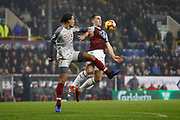 Liverpool defender Virgil van Dijk and Burnley's Sam Vokes contest an aerial ball  during the Premier League match between Burnley and Liverpool at Turf Moor, Burnley, England on 5 December 2018.