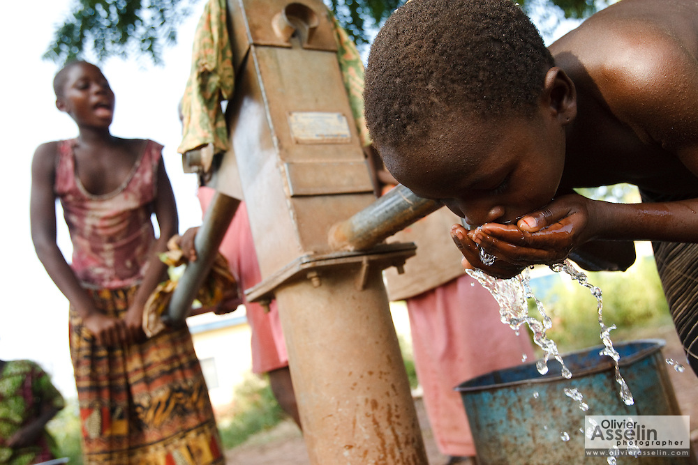 A girl drinks from a hand pump in the village of Moglaa, Ghana on Thursday November 11, 2010.