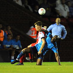 TELFORD COPYRIGHT MIKE SHERIDAN 7/8/2018 - Theo Streete battles for the ball with Sam Austin during the National League North fixture between Kidderminster Harriers FC vs AFC Telford United.