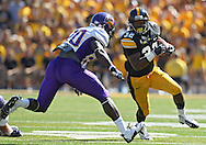 September 15 2012: Iowa Hawkeyes running back Damon Bullock (32) eyes Northern Iowa Panthers defensive back Wilmot Wellington (20) on a run during the first quarter of the NCAA football game between the Northern Iowa Panthers and the Iowa Hawkeyes at Kinnick Stadium in Iowa City, Iowa on Saturday September 15, 2012. Iowa defeated Northern Iowa 27-16.