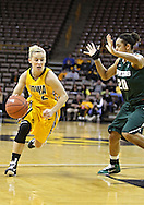 January 27 2010: Iowa guard Kamille Wahlin (2) drives around Michigan St. guard Brittney Thomas (20) during the first half of an NCAA women's college basketball game at Carver-Hawkeye Arena in Iowa City, Iowa on January 27, 2010. Iowa defeated Michigan State 66-64.