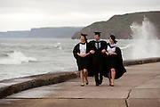 13 July 2012: Scarborough, North Yorkshire.<br /> Graduates dodge the waves in Scarborough today on their way to their degree ceremony at the  University of Hull Scarborough Campus.<br /> Picture: Sean Spencer/Hull News & Pictures<br /> 01482 210267/07976 433960<br /> www.hullnews.co.uk   sean@hullnews.co.uk