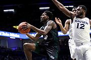 Green Bay's Josh McNair (12) drives past Xavier's Dontarius James (12) during an NCAA college basketball game, Wednesday, Dec. 4, 2019, in Cincinnati. Xavier defeated Green Bay 84-71 (Jason Whitman/Image of Sport)