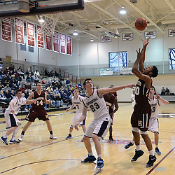 TOM KELLY IV - DAILY TIMES<br /> Haverford's Lamar Stevens (30) pulls down a rebound over Episcopal's Nick Alikakos (23) during the Episcopal Academy vs The Haverford School boys basketball game as part of the Daniel Dougherty tournament at Philadelphia University on Saturday, January 3, 2015.