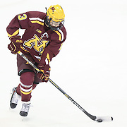 Taylor Cammarata #13 of the Minnesota Gophers warms up on the ice prior to the game against the Northeastern Huskies at Matthews Arena on November 29, 2014 in Boston, Massachusetts. (Photo by Elan Kawesch)