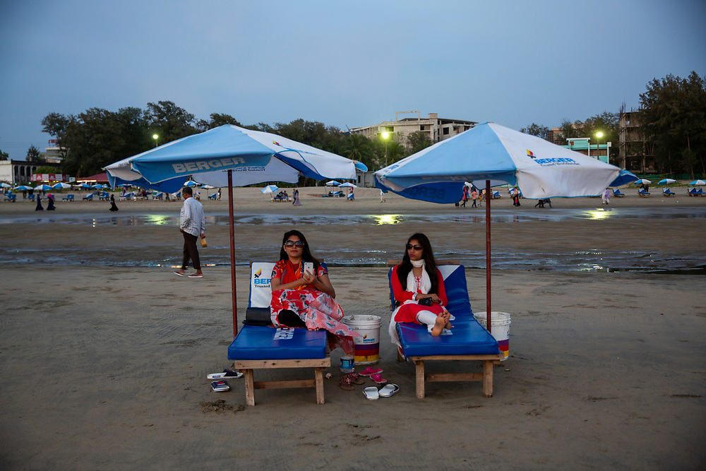 Two Asian women relax on sun-loungers on Laboni Beach in Cox Bazar, Chittagong Division, Bangladesh, Asia.  (photo by Andrew Aitchison / In pictures via Getty Images)