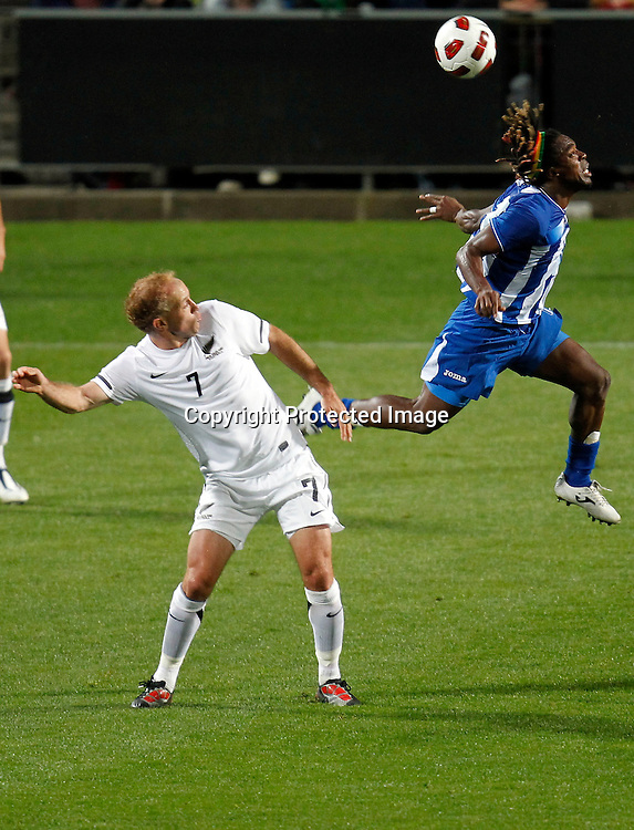Honduras's Walter Martinez flies past NZ's Simon Elliott. ASB International Series, All Whites v Honduras, North Harbour Stadium Albany, Saturday 9th October 2010. Photo: Shane Wenzlick