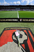 Flowers laid on the AFC Bournemouth logo next to the pitch in tribute to the Hillsborough Anniversary before the Barclays Premier League match between Bournemouth and Liverpool at the Goldsands Stadium, Bournemouth, England on 17 April 2016. Photo by Graham Hunt.