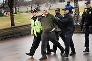 """A man was arrested for assaulting a police officer Tuesday during the 'Occupy Congress"""" protests on Capitol Hill. Hundreds of protestors with the Occupy movements gathered outside the Capitol, waving signs and chanting against a barrier of police."""