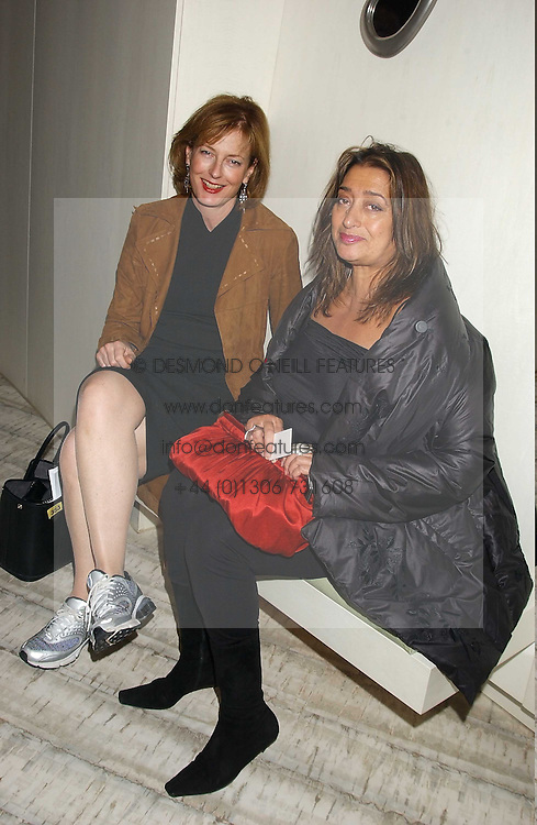 Left to right, JULIA PEYTON-JONES and ZAHA HADID at a dinner hosted by Arnaud Bamber MD of Cartier, Amanda Sharp and Matthew Slotover Directors of the Frieze Art Fair to celebrate artists featured in the 2005 Frieze Art Fair Curatorial Programme at Nobu-Berkeley, 15th Berkeley Street, London on 21st October 2005.<br />