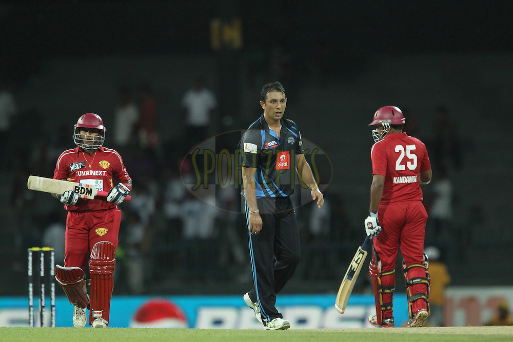 Azhar Mahmood walks back as the runs are made during the first Semi Final Match of the Sri Lankan Premier League between Uva Next and Wayamba United held at the Premadasa Stadium in Colombo, Sri Lanka on the 28th August 2012. .Photo by Ron Gaunt/SPORTZPICS/SLPL