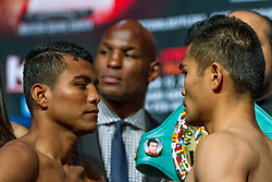 "NEW YORK, NY - OCT 16: Roman ""chocolatito"" Gonzalez 43-0 (37 KOs) and Brian Viloria 36-4 (22 KOs) stopped the weight at 111.4lbs at the official weigh in for their bout saturday at Madison Square Garden on 16 October, 2015 in New York, NY USA. Byline, credit, TV usage, web usage or linkback must read SILVEXPHOTO.COM. Failure to byline correctly will incur double the agreed fee. Tel: +1 714 504 6870."