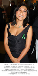 PAMELA MAE mother of violinist Vanessa Mae, at a party in London on 4t September 2003.PME 15