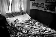 Elizabeth in her brother's bedroom at home.