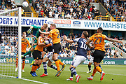 Millwall attacking in the Hull City goalmouth, Hull City goalkeeper George Long (1) tips the ball over the bar, during the EFL Sky Bet Championship match between Millwall and Hull City at The Den, London, England on 31 August 2019.