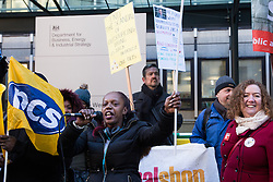 London, UK. 22nd January, 2019. Anna, a member of the support staff at the Department for Business, Energy and Industrial Strategy (BEIS) represented by the Public and Commercial Services (PCS) union, addresses supporters on the picket line after beginning a strike for the London Living Wage of £10.55 per hour and parity of sick pay and annual leave allowance with civil servants. The strike is being coordinated with receptionists, security staff and cleaners at the Ministry of Justice (MoJ) represented by the United Voices of the World (UVW) trade union.