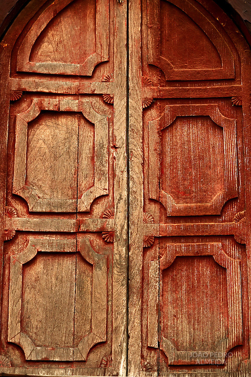 Wood door of monastery at Nyaubgshwe