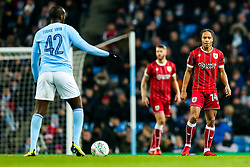 Bobby Reid of Bristol City looks on as Yaya Toure of Manchester City controls the ball - Rogan/JMP - 09/01/2018 - Etihad Stadium - Manchester, England - Manchester City v Bristol City - Carabao Cup Semi Final First Leg.