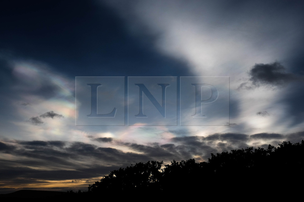 **CAPTION CORRECTION - Clouds in this image are Nacreous clouds, not Sirrus clouds stated in earlier captions** © Licensed to London News Pictures.01/02/16<br /> <br /> Nacreous clouds, also known as mother-of-pearl clouds, give off an unusually array of colours over Saltburn-by-the-Sea. Nacreous clouds are seen mostly during winter at high latitudes like Scandinavia, Iceland, Alaska and Northern Canada and sit in the lower stratosphere some 15 - 25 km high, well above tropospheric clouds.<br /> <br /> Photo credit : Ian Forsyth/LNP