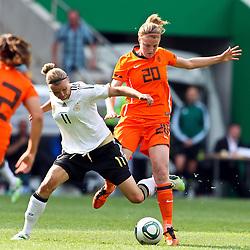 07-06-2011 VOETBAL: DUITSLAND - NEDERLAND: AACHEN<br /> Zweikampf zwischen Alexnadra Popp (Deutschland, Duisburg) (L) und Kirsten van de Ven (Niederlande, Tilburg)  // during the WM 2012 Friendly Game Germany vs Netherland at Tivoli Aachen <br /> *** NETHERLANDS ONLY ***<br /> ©2011-FotoHoogendoorn.nl/ nph / Mueller